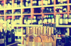 Closeup view on various alcohol beverage bottles. In wine shop Royalty Free Stock Photography