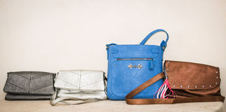 Closeup view of various stylish fashionable stylish leather ladies purses Royalty Free Stock Photos