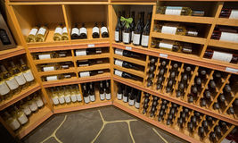 Closeup view of various wine on wooden shelf`s inside wine store in Toronto. Toronto, Ontario, Canada, wine store, June 16, 2017, great, nice closeup view of Royalty Free Stock Photo
