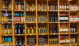 Closeup view of various wine on wooden shelf`s inside wine store in Toronto. Toronto, Ontario, Canada, wine store, June 16, 2017, great, nice closeup view of Royalty Free Stock Photography
