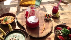 Closeup view of vegetarian food on rustic wooden table stock video