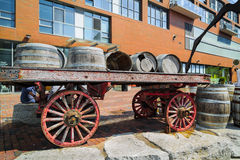 Closeup view of vintage classic horse drawn carriage loaded with wooden barrels Royalty Free Stock Image