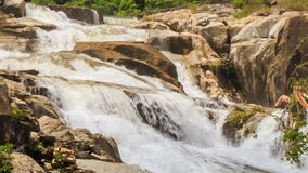 Closeup view of waterfall among rocks in park. Closeup view of waterfall cascade among rocks in tropical park stock footage