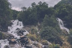 Closeup view waterfall scene in mountains, national park of Dombay, Caucasus. Russia. Summer landscape, sunshine weather and sunny day stock image