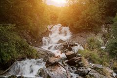 Closeup view waterfall scene in mountains, national park of Dombay, Caucasus. Russia. Summer landscape, sunshine weather and sunny day stock images