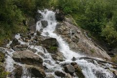Closeup view waterfall scene in mountains, national park of Dombay, Caucasus. Russia. Summer landscape, sunshine weather and sunny day royalty free stock photos