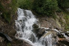 Closeup view waterfall scene in mountains, national park of Dombay, Caucasus. Russia. Summer landscape, sunshine weather and sunny day stock photography
