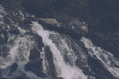 Closeup view waterfall scene in mountains, national park of Dombay, Caucasus. Russia. Summer landscape, sunshine weather and sunny day royalty free stock photography