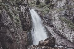 Closeup view of waterfall scenes in mountains, national park Dombay, Caucasus. Russia, Europe. Summer landscape and sunny day stock photography