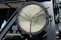 Closeup view of the weathered electrical headlight of a steam lo Royalty Free Stock Image