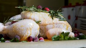 Closeup view of Whole Raw Chicken with Fresh parsley Cranberries and Orange Slices on baking tray tin prepared for Royalty Free Stock Photo