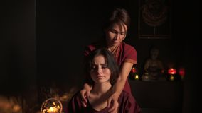 Closeup view of woman`s neck and shoulders having thai massage in spa by a female massagist. Healthcare and spa concept stock footage