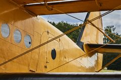Closeup view of yellow Antonov An-2 airplane. stock photography