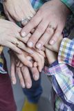 Closeup View of Young Caucasian People Connecting Their Hands Together. Stack of Five Pairs of Hands Demonstrating Unity, Teamwork and Friendship royalty free stock photo