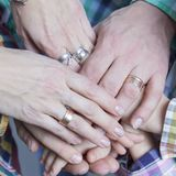 Closeup View of Young Caucasian People Connecting Their Hands Together. Stack of Five Pairs of Hands Demonstrating Unity, Teamwork and Friendship stock photos