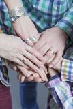 Closeup View of Young Caucasian People Connecting Their Hands Together. Stack of Five Pairs of Hands Demonstrating Unity, Teamwork and Friendship royalty free stock photos