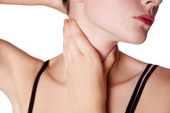 Closeup view of a young woman with pain on neck or thyroid gland. Stock Photos
