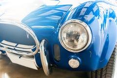 Closeup of a vintage blue sport car Stock Images