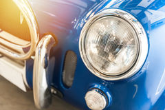 Closeup of a vintage blue sport car Royalty Free Stock Photo