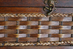 Closeup vintage brown wicker box with metal lock Royalty Free Stock Photography