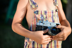 Closeup of vintage camera which is holding by Royalty Free Stock Images