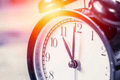 Closeup vintage clock selective focus at number 11 o`clock Royalty Free Stock Images