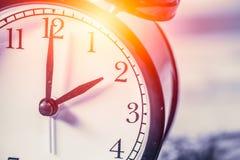 Closeup vintage clock selective focus at number 2 o`clock Stock Images