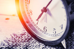 Closeup vintage clock selective focus at number 7 o`clock Royalty Free Stock Image