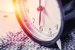 Closeup vintage clock selective focus at number 6 o`clock Stock Photos