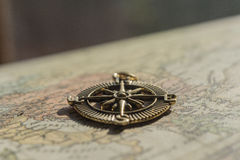 Closeup of vintage compass lying on an old world map Royalty Free Stock Photography