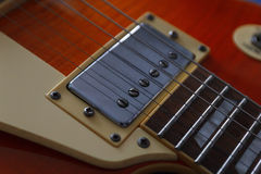 Closeup of vintage electric guitar. Detail, selective focus. Low key. Stock Photography