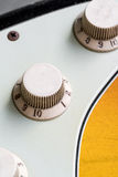 Closeup of vintage electric guitar knobs Stock Photo
