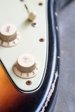 Closeup of vintage electric guitar tone knobs Royalty Free Stock Photos