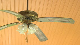 Closeup of the vintage fan lamp hanging on the ceiling