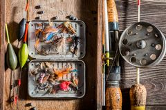 Closeup of vintage fishing tackle with net and rods royalty free stock images