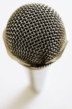 Vintage microphone over white Royalty Free Stock Image