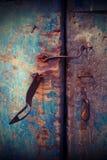 Closeup vintage old metal door. Closeup vintage blue metal door in grungy style Stock Image