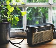 Closeup of vintage radio on wooden table Stock Photography