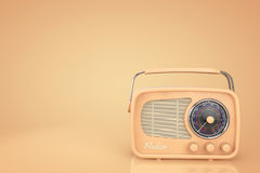 Closeup Vintage Radio. On a yellow background Stock Photography