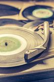 Vintage record player and vinyls as toned photo. Closeup of vintage record player and vinyls as toned photo royalty free stock photo