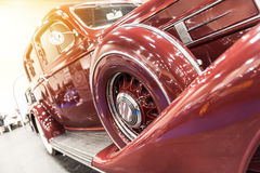 Closeup of a vintage red car Stock Images