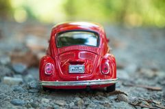 Closeup of vintage red miniature volkswagen bettle in outdoor. Mulhouse - France - 16 October 2018 - closeup of vintage red miniature volkswagen bettle in royalty free stock photo