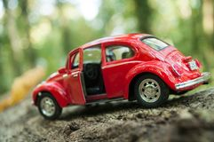 Closeup of vintage red miniature volkswagen bettle in outdoor. Mulhouse - France - 16 October 2018 - closeup of vintage red miniature volkswagen bettle in royalty free stock image