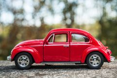 Closeup of vintage red miniature volkswagen bettle in outdoor. Mulhouse - France - 16 October 2018 - closeup of vintage red miniature volkswagen bettle in stock images