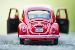 Closeup of vintage red miniature volkswagen bettle in outdoor. Mulhouse - France - 16 October 2018 - closeup of vintage red miniature volkswagen bettle in stock photos