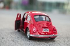 Closeup of vintage red miniature volkswagen bettle in the street. Mulhouse - France - 17 October 2018 - closeup of vintage red miniature volkswagen bettle in the royalty free stock image