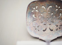 Closeup of a vintage slotted serving utensil Royalty Free Stock Images