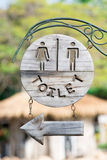 Closeup vintage Toilet Wooden Sign in a park Royalty Free Stock Photos