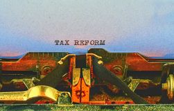 Closeup on vintage typewriter. Front focus on letters making TAX REFORM text. Business concept image with retro office tool.  stock images