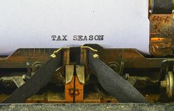 Closeup on vintage typewriter. Front focus on letters making TAX SEASON text. Business concept image with retro office tool.  royalty free stock images
